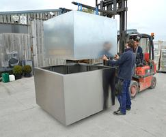 Large, bespoke stainless steel tree planters