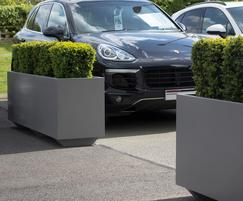 Bespoke movable steel planters for Porsche forecourt