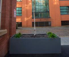 Bespoke powder coated planters for historic urban