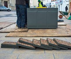 Steel tree planters with resin-bound gravel lids