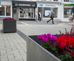 Square street planters in FRC material