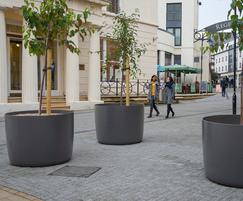 Large round FRC planters in pedestrianised area