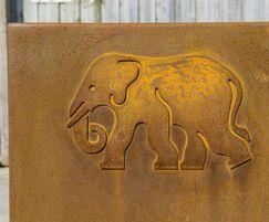 Each steel planter has a laser-cut elephant decal