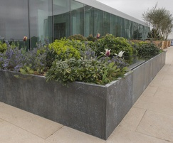Made-to-order zinc planters and zinc-clad water feature
