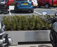 Stainless steel planters can be used as barriers