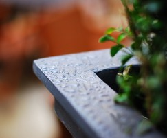 Close up of steel planter clad in lead
