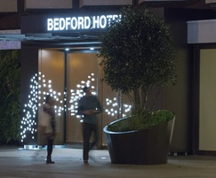 Entrance to Bedford Hotel in London at night