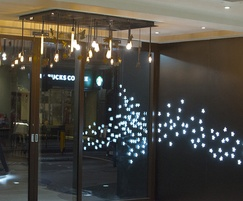 Interior lighting and illuminated laser cut cladding