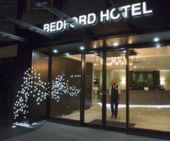 Illuminated signage and laser cut cladding at hotel