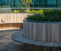 Iroko timber seating with stainless steel armrests