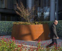Bespoke asymmetrical round planter in corten steel