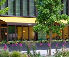 Signal black steel planters surround restaurant