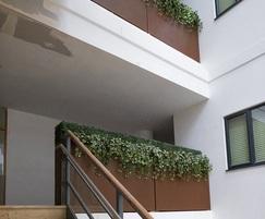 Large corten effect steel planters create barrier