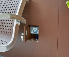 Hinged door on planter for socket access