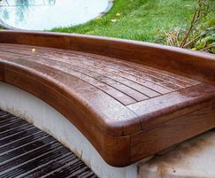 Timber oak seating stained to look like teak