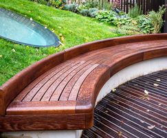 Curved timber seating edge to roof garden
