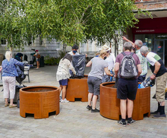 Air Quality Brentford volunteers fill the planters