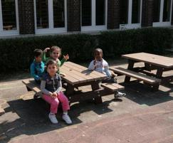 Junior recycled plastic picnic tables in playground