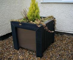Plaza recycled plastic planter in garden