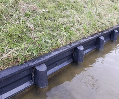 Recycled plastic sheets and plastic coated timber piles