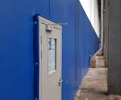 Steel pedestrian escape doors with vision panels