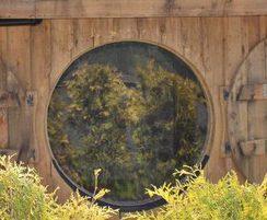 Circular windows with shutters