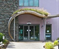 Curved green roof entrance canopy