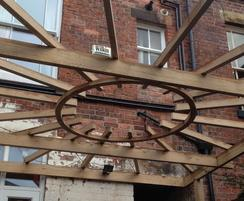 Oak pergola with steam-bent central ring