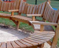 Spiral curved timber seats