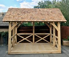 Oak-framed summerhouse with cedar shingle roof