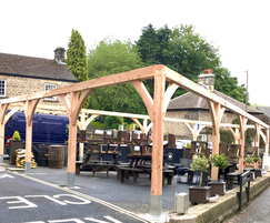 Wooden pergola for outdoor eating area