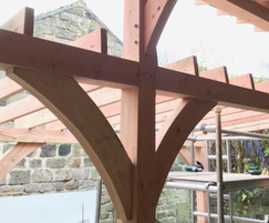Timber-framed green roof shelter made from Douglas Fir