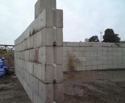 V-interlocking concrete building blocks in wall