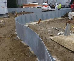 Construction photograph of steel retaining wall