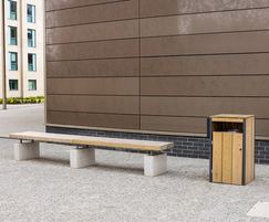 Timber and granite bench with litter bin