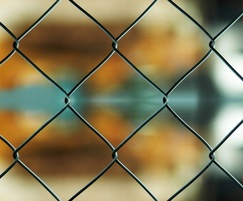 Detail of chain link fencing for sports pitch
