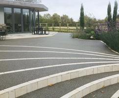 Resin bound decorative stepway from patio to garden