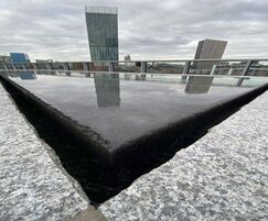 Water flows evenly across the surface of the stone
