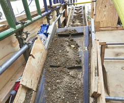 Conveyor for soil, aggregate, and small rubble
