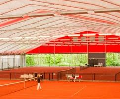 Permanent sports structure over tennis courts