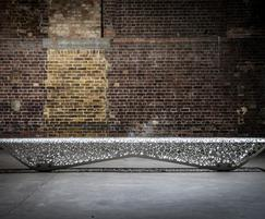 OSSO mild steel outdoor bench is almost 4m long