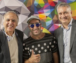 The panels feature the art of Okuda San Miguel (centre)