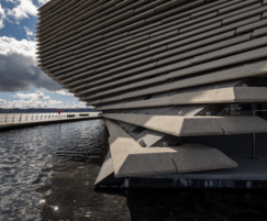 The water pool reflects the architecture at V&A Dundee