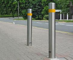 Satin stainless steel security bollard with orange tape