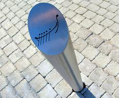 Sloped stainless steel bollard with etched infill graph