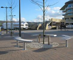 Zenith curved benches in stainless steel with iroko