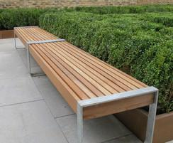 Two benches joined to create a continuous seating run