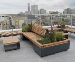 Railroad planters with integrated seating platforms