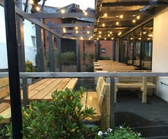 Stark table and seats for restaurant outdoor area