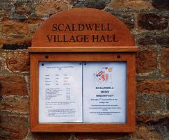 Small oak poster case for village hall